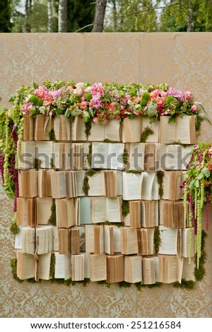 wedding photo-booth decoration zone decorated with a lot of books - stock photo
