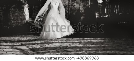 wedding photo of happy bride in black and white
