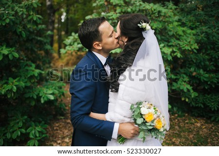 Wedding photo shoot. Beautiful groom and bride in nature