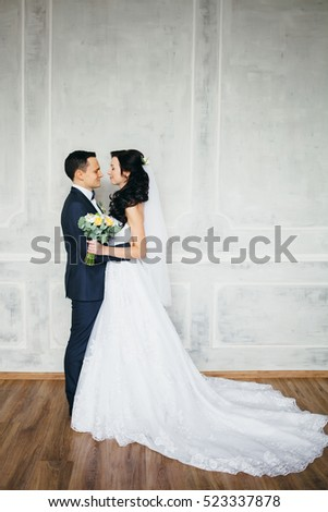 Wedding photo shoot of the newlyweds in a beautiful Studio interior