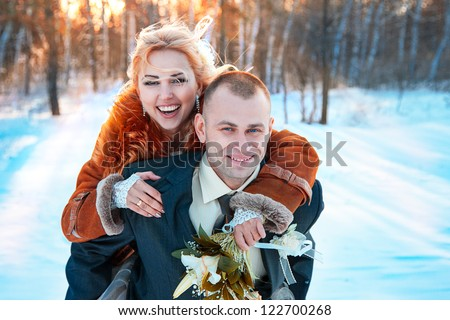 Wedding photography in winter forest - stock photo