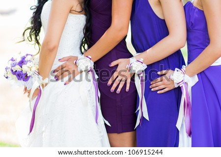 Wedding picture with bridesmades and flowers - stock photo