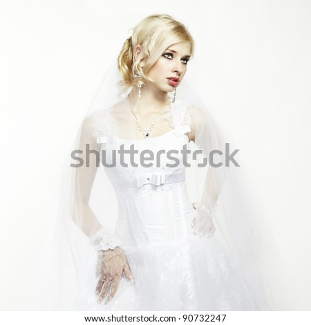 Wedding portrait of beautiful young bride - stock photo