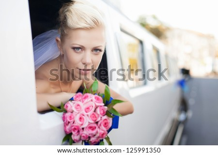 wedding portrait of bride in car window - stock photo