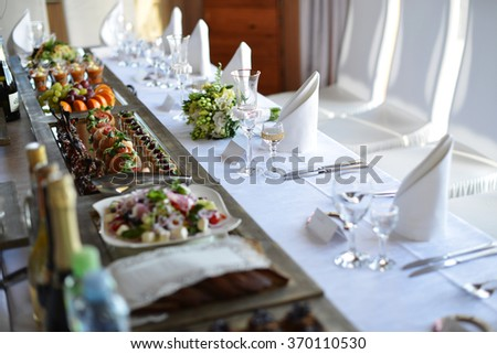Wedding reception place ready for guests. table with food and drink - stock photo