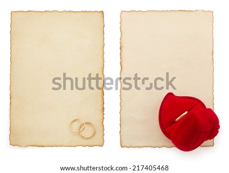 wedding ring and aged paper isolated on white background