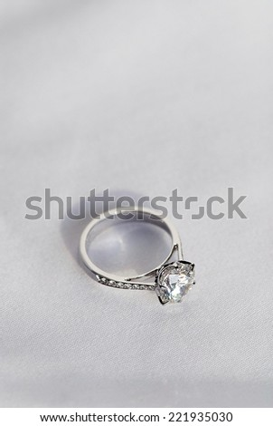 wedding ring on fabric background
