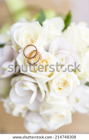 Wedding ring on the bouquet