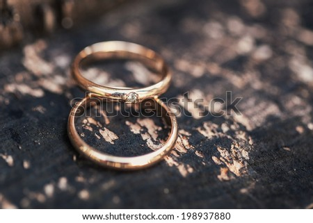 Wedding-ring on whooden surface - stock photo