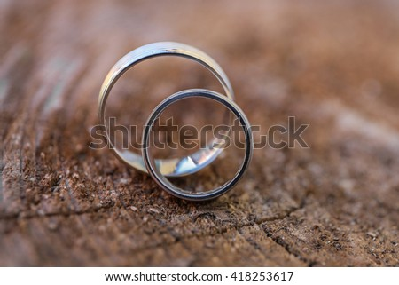 wedding ring the wood of the block