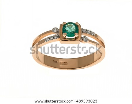 Wedding ring with diamonds and emeralds isolated on white...