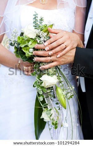 wedding rings and bridal bouquet - stock photo