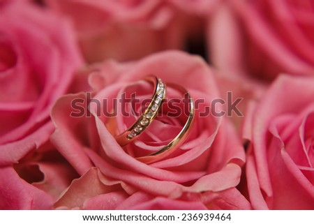 wedding rings and bride's bouquet macro shoot - stock photo
