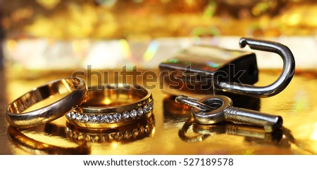 Wedding rings and clock