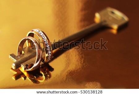 Wedding rings and golden key