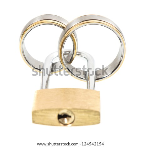 wedding rings and key lock over white background. marriage concept. selective focus