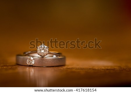 wedding rings and noise background - stock photo
