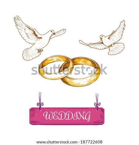 Wedding rings and pigeons - stock photo