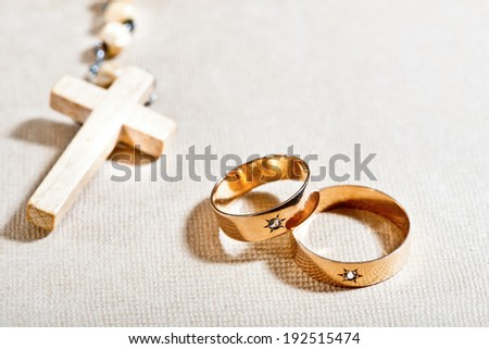 wedding rings and rosary - stock photo