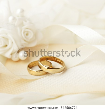 wedding rings and wedding invitation - stock photo