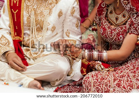 Wedding rings at the indian ceremony - stock photo