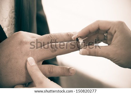 Wedding rings. Closeup of hands of bridal couple with wedding rings