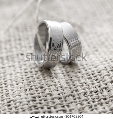 Wedding rings Engraved With The Lords Prayer In Serbian - stock photo
