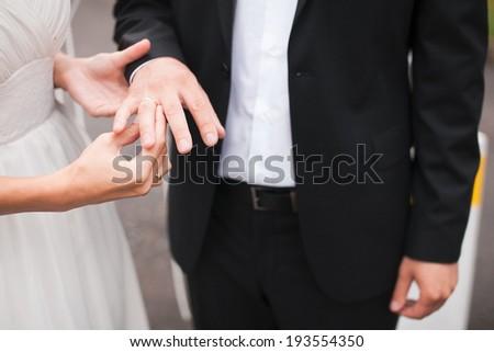 Wedding rings exchange - stock photo