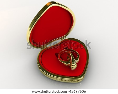 Wedding rings in a box on white background