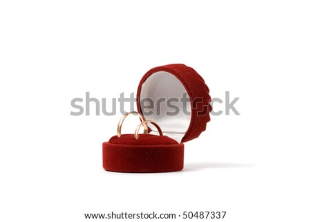 Wedding rings in a heart shaped box - stock photo