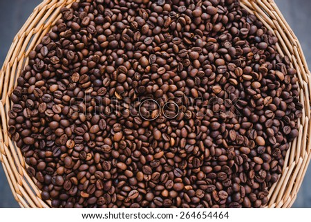Wedding rings in coffee grains - stock photo