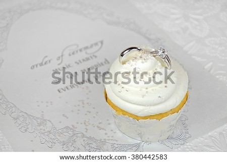 wedding rings in cupcake icing on contemporary wedding invitation