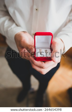 Wedding rings in fiances hands - stock photo