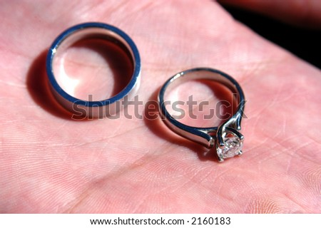 Wedding rings in hand - stock photo