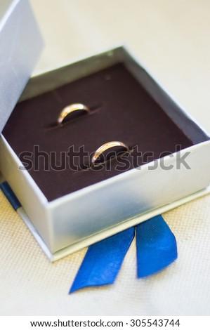 Wedding rings in the silver box black suede velvet inside - stock photo