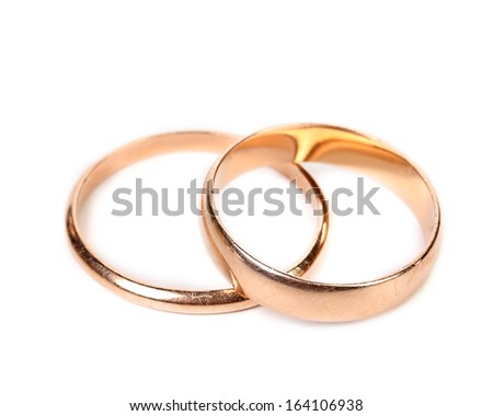 Wedding rings. Isolated on a white background. - stock photo