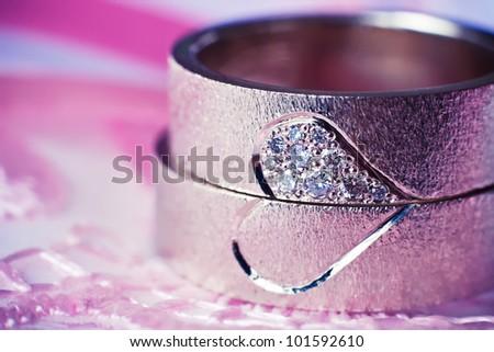 wedding rings on a cushion - stock photo
