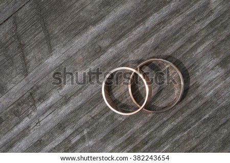 Wedding rings on a wooden surface - stock photo