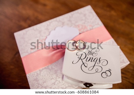 Wedding Gift Card Inscriptions : Wedding rings on box with inscription