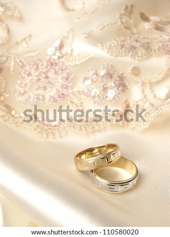 Wedding rings on ceremony fabrics
