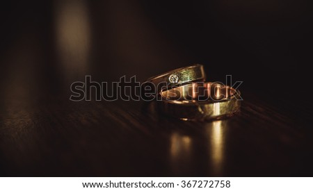 wedding rings on dark background