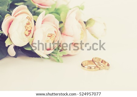 Wedding rings on table with vintage tone