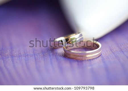 Wedding rings on the table - stock photo