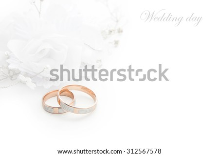 Wedding rings on wedding card on a white background - stock photo