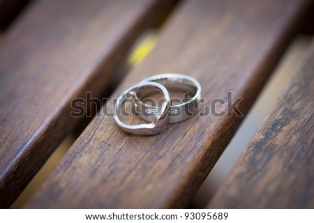 Wedding rings on Wooden seat
