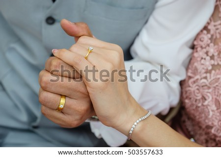 wedding rings together in hands