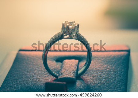 wedding rings,vintage color toned image - stock photo