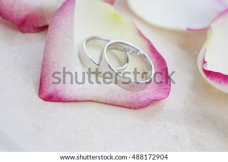 Wedding rings with beautiful rose blossom company