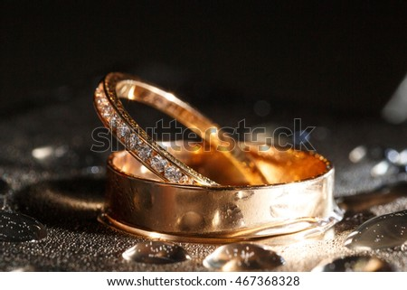 wedding rings with brilliant on black background;Focus on brilliant