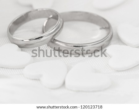 wedding rings with heart decoration - stock photo